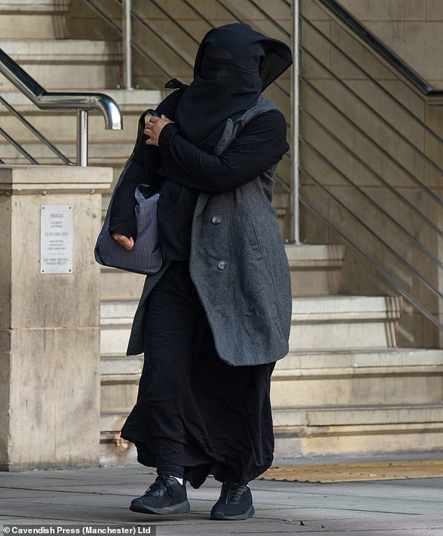 Mother of eight hides behind burkah as she's charged for fleecing taxpayers out of over £100,000 worth of benefits for relatives in Pakistan