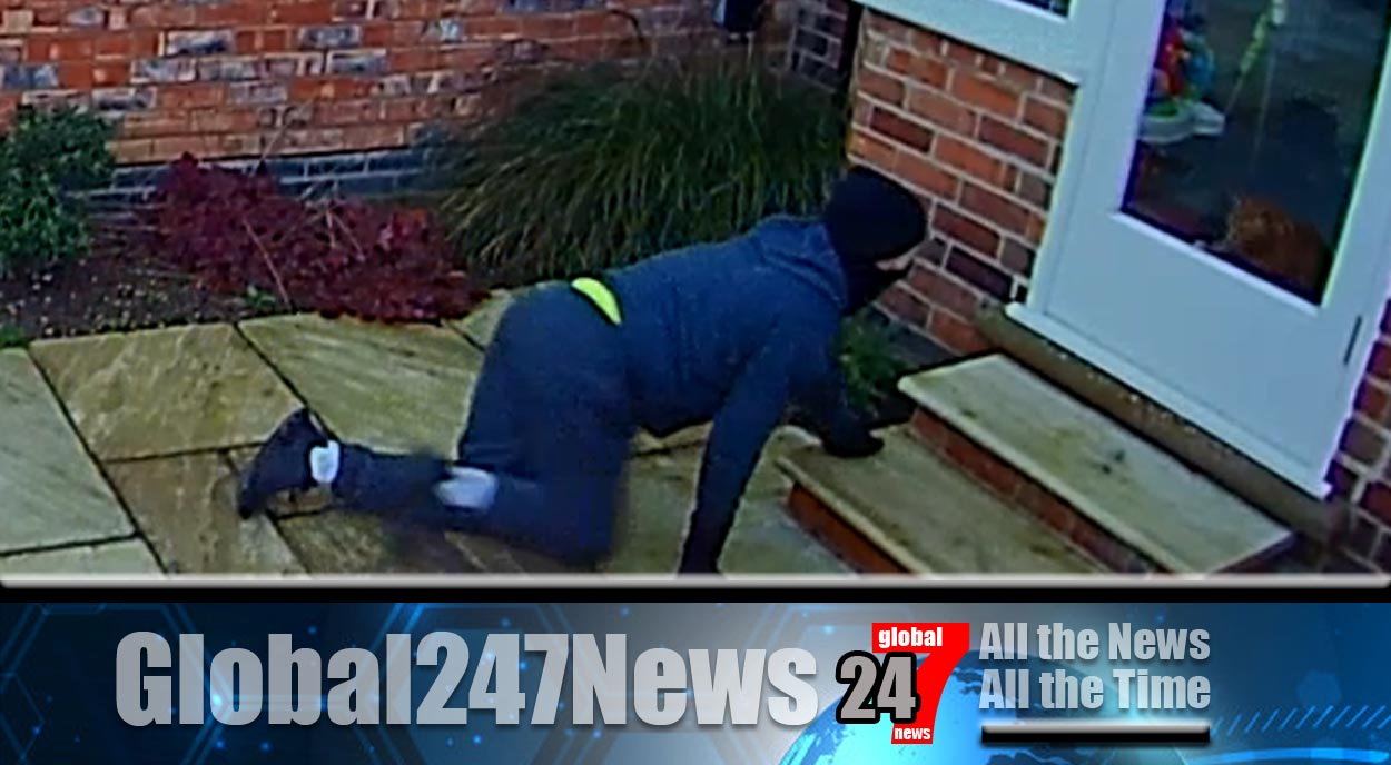 Homeowners who watched a burglar casing their house and prowling around in the garden caught the moment on CCTV that he came face to face with their pet cat.