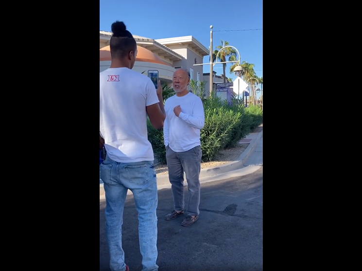 Racist loses real estate job after being filmed telling black men this is a 'No Ni**er zone'