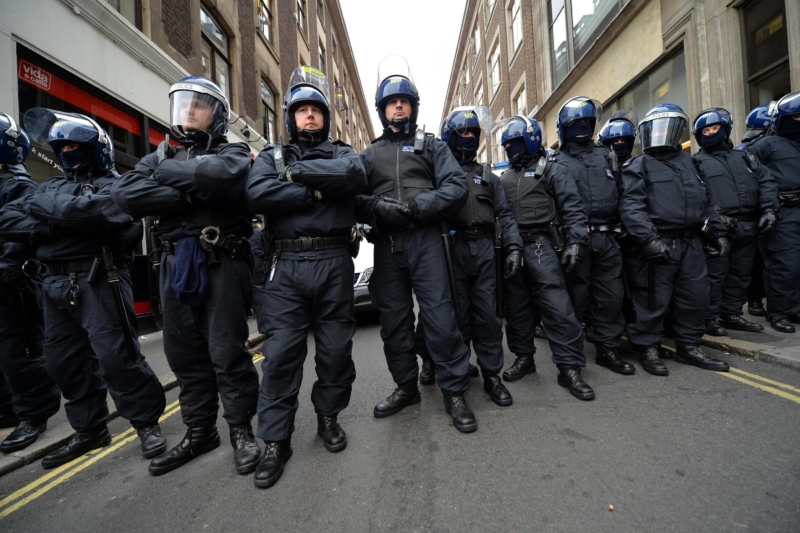 Riot police deployed after gang of youths attack police officers and vehicles