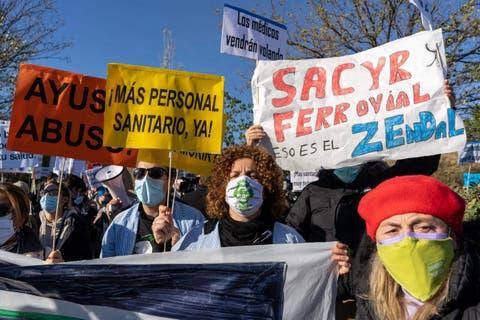 Four thousand furious health workers take to the streets in Spain's Madrid