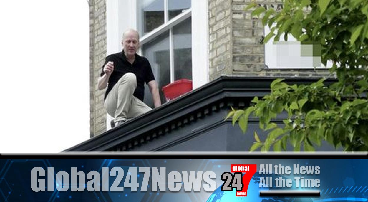 Comedian Adrian Edmondson rescued from window ledge