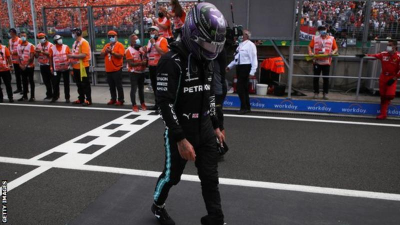 """After finishing Sunday's eventful race at the Hungaroring, won by Alpine's Esteban Ocon, Hamilton took part in the podium ceremony before seeking medical attention. """"I have been fighting all year with my health after what happened at the end of last year and it is still a battle,"""" he said."""